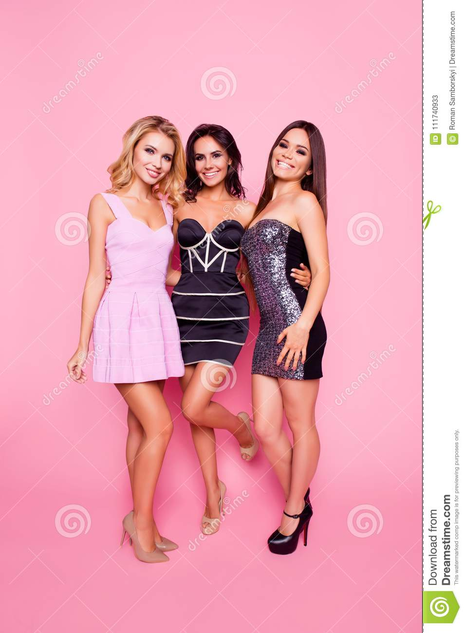 Bachelor hen party! Portrait of three cute, nice, slim, attractive girls with long legs, enjoying time together, posing for photo,