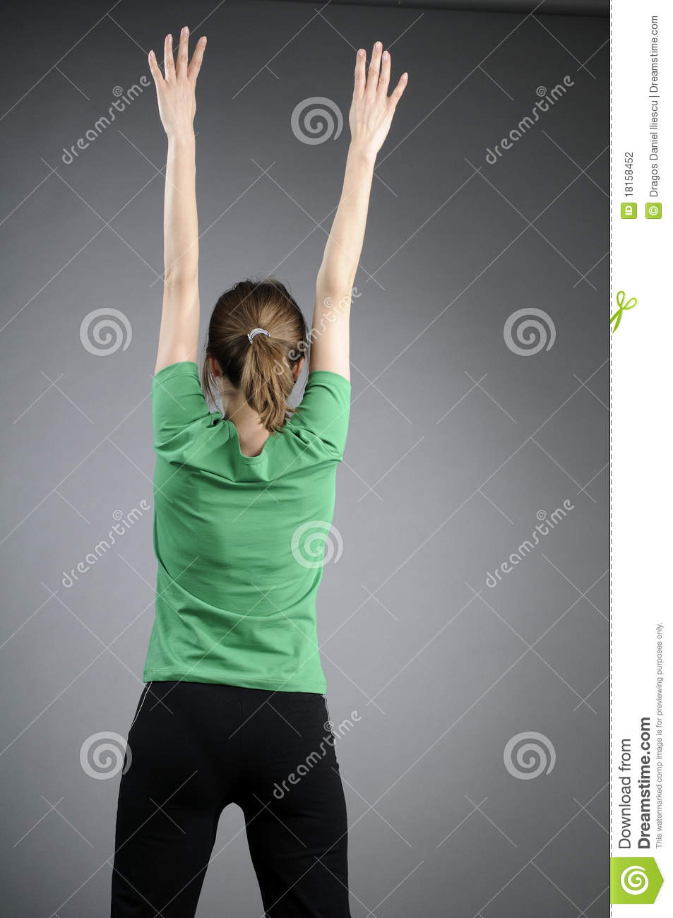 Back of adult person exercising