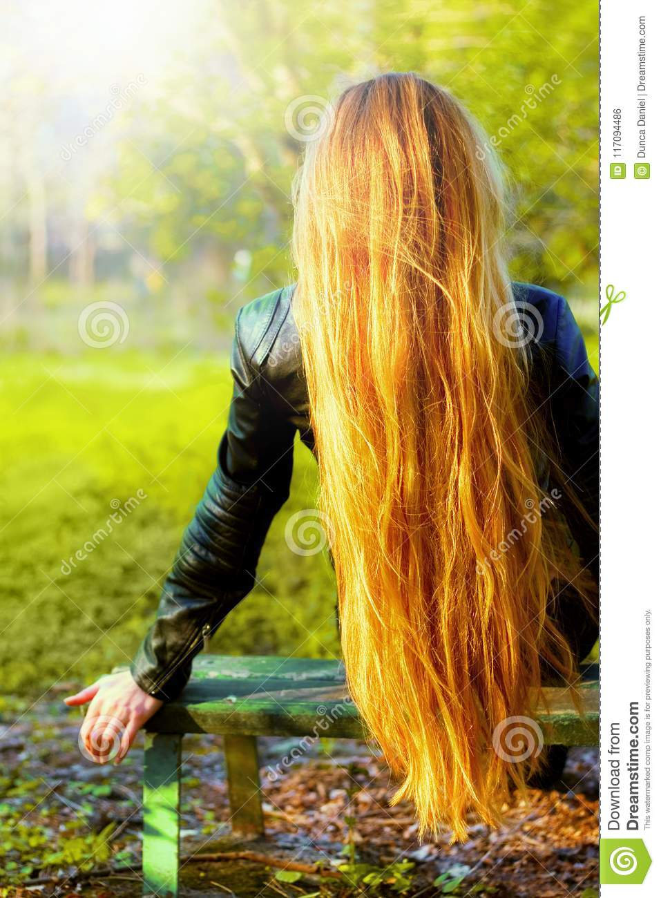 Back of blonde woman with natural long hair
