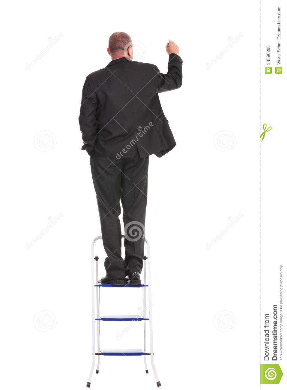 back of business man writing on a ladder stock photo