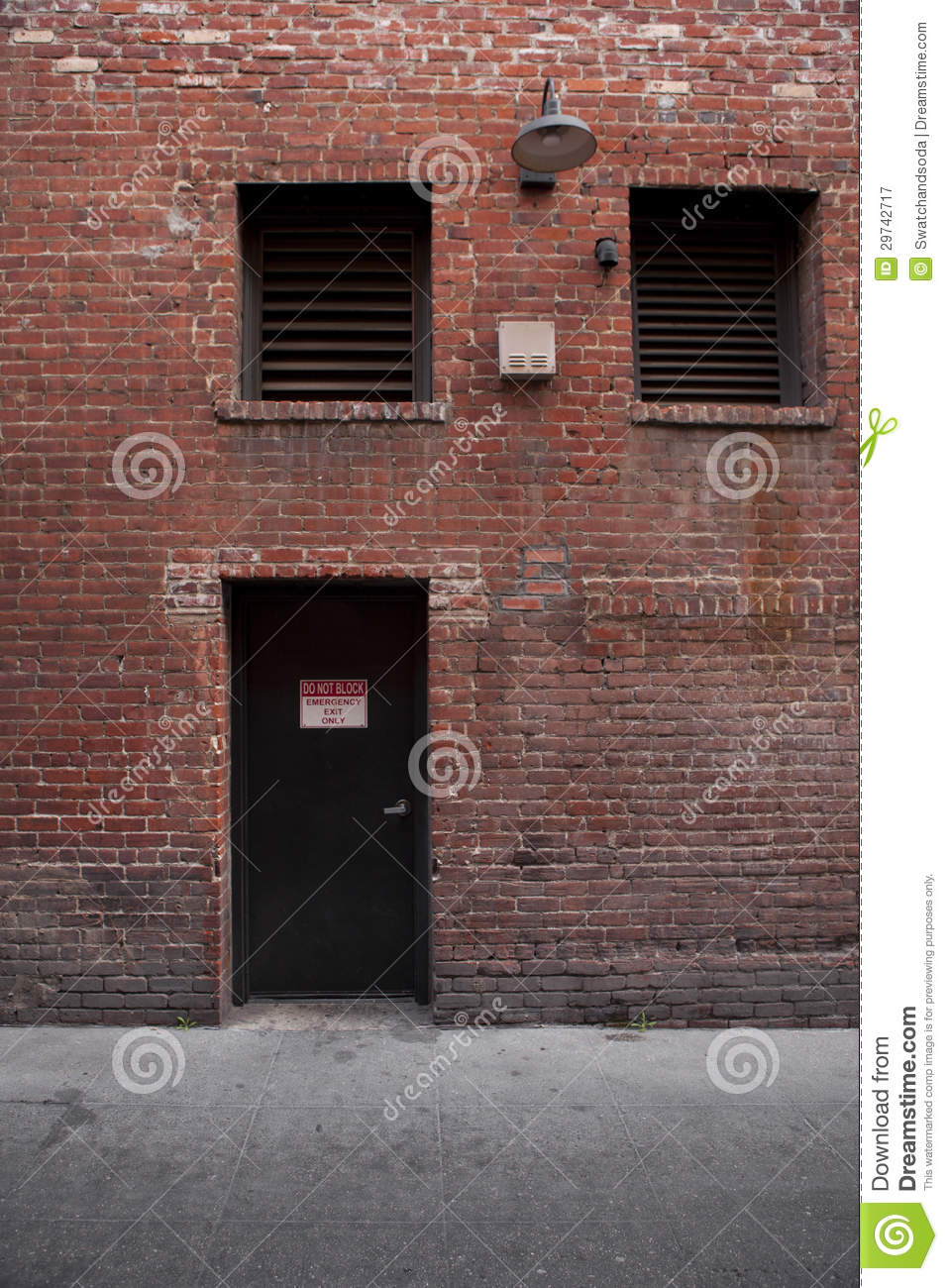 Alley entrance backside of brick building royalty free for Back door entrance