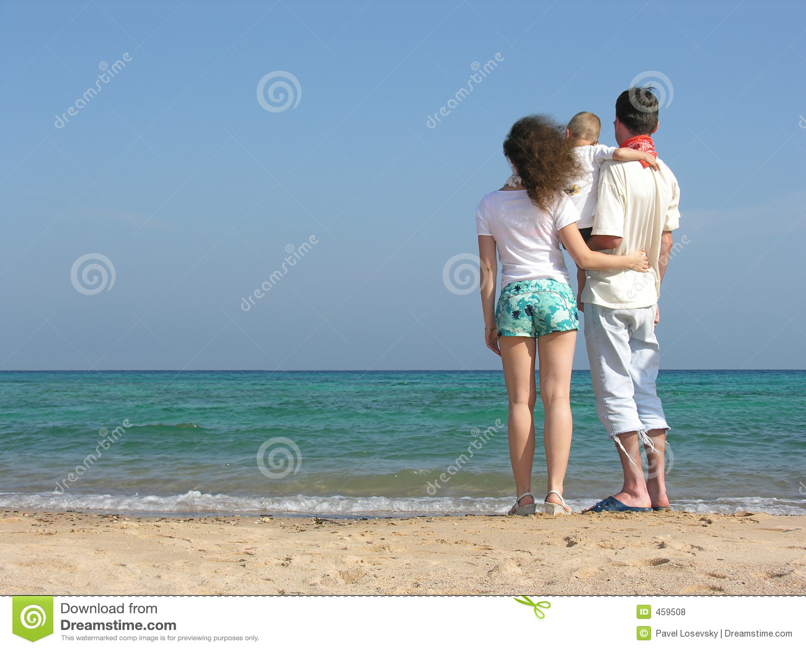 Back family of three on beach