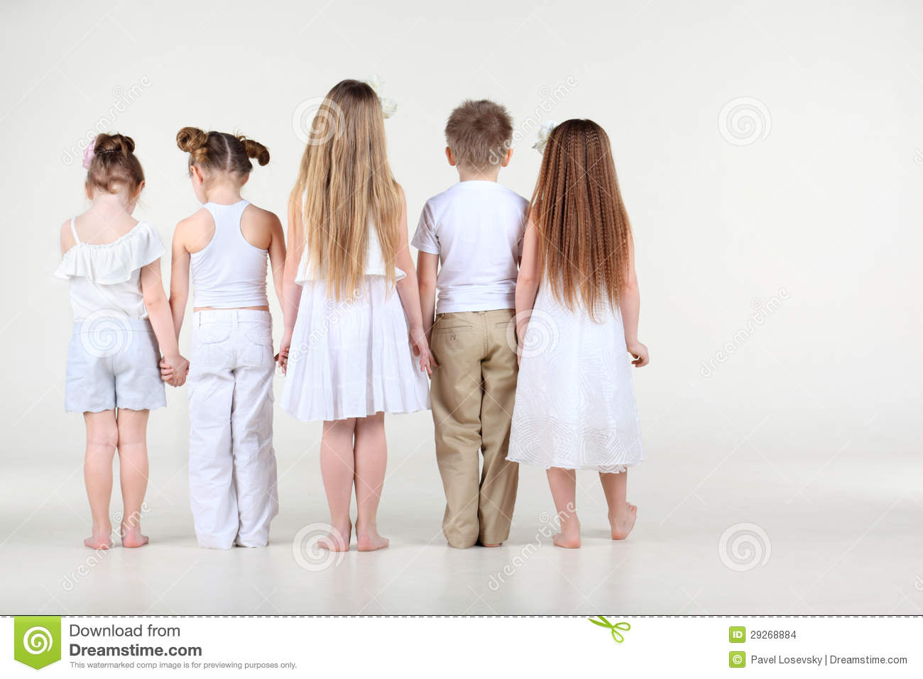 back of four cute little girls and one boy in white clothes standing