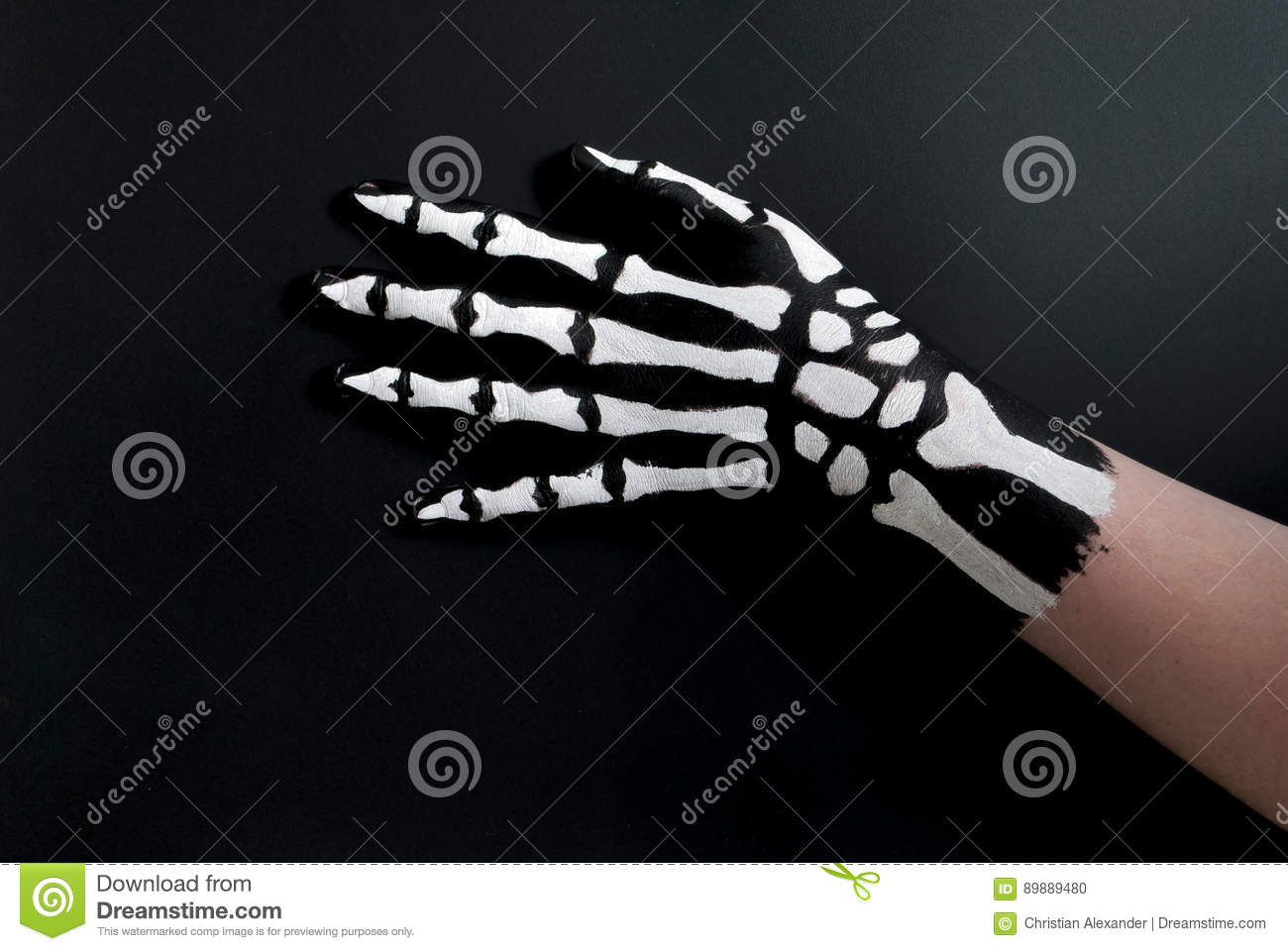 Back of hand painted to look like bones for halloween