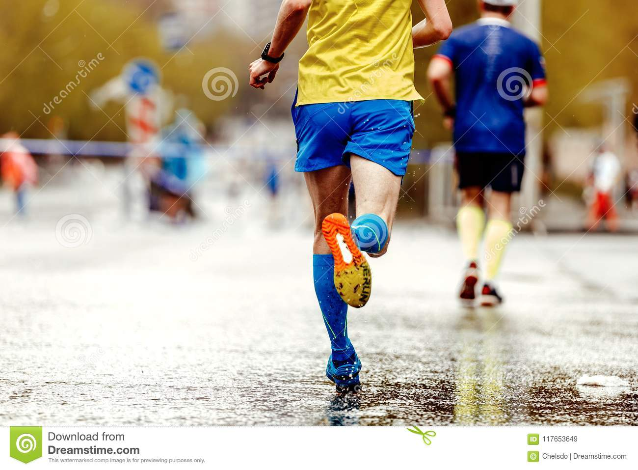 21b1ab8615 Back runner athlete in compression socks run city a water spray from under  feet