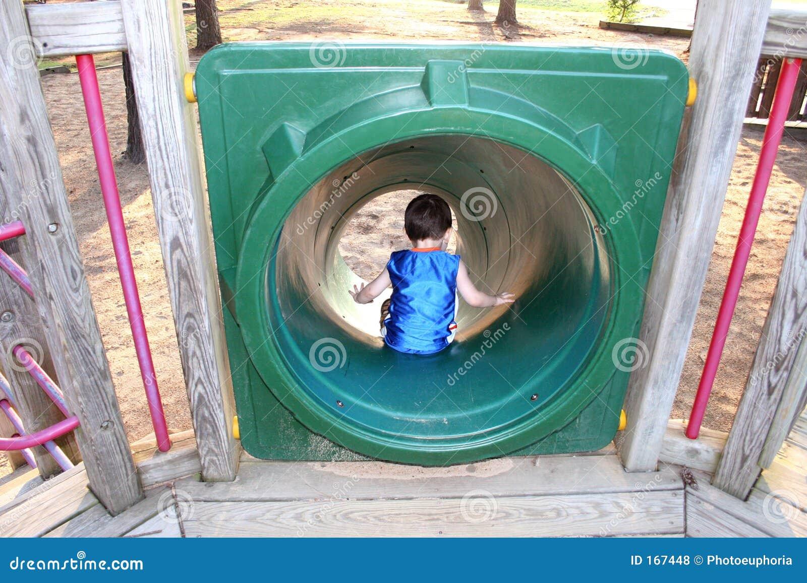 Back Side of Boy Going Down Park Slide