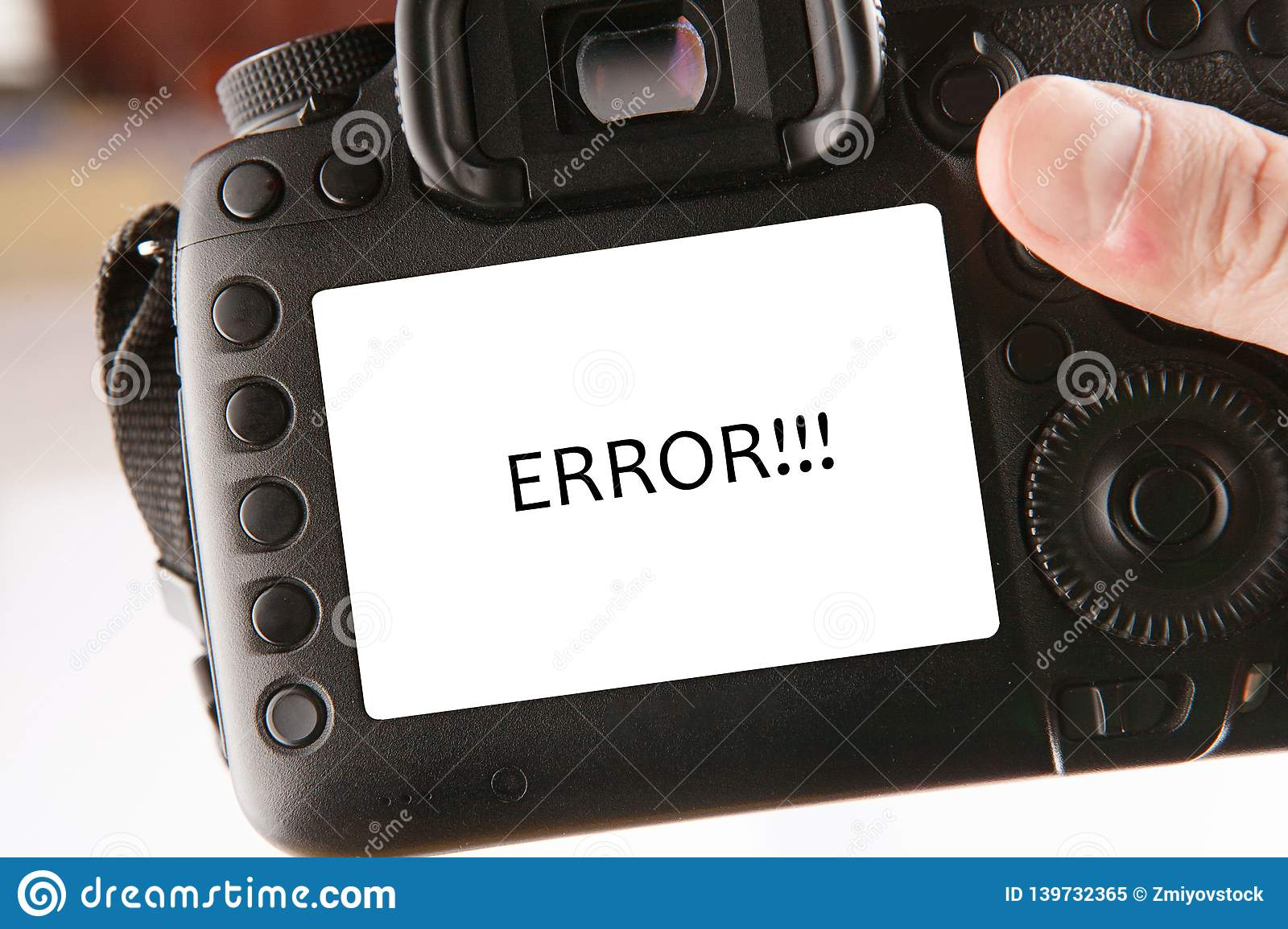 Back side of professional dslr digital photo camera with text error on screen
