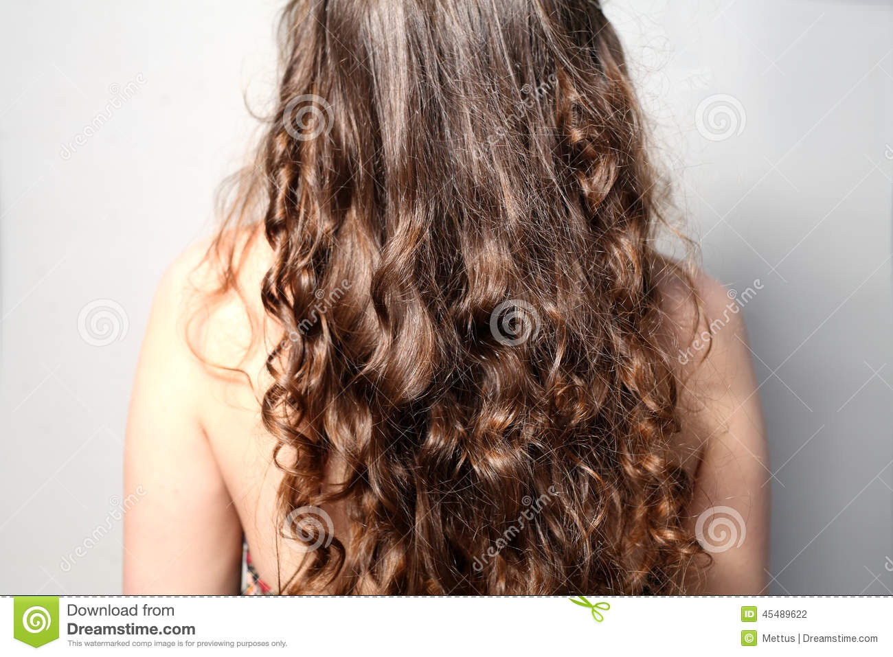 back side view rear of young female curly hair stock photo