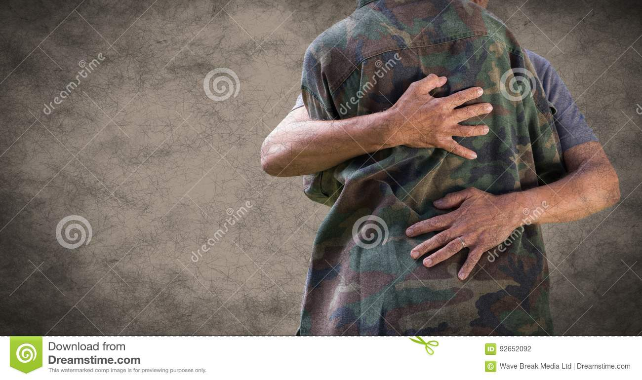 Back of soldier hugging against brown background with grunge overlay