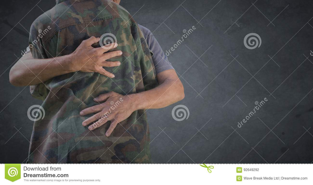 Back of soldier hugging against grey background with grunge overlay
