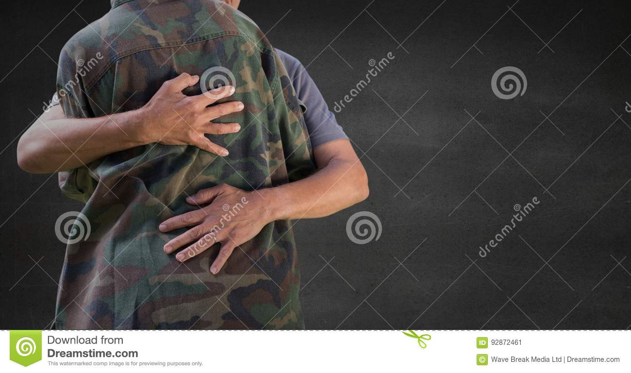 Back of soldier hugging against grey wall