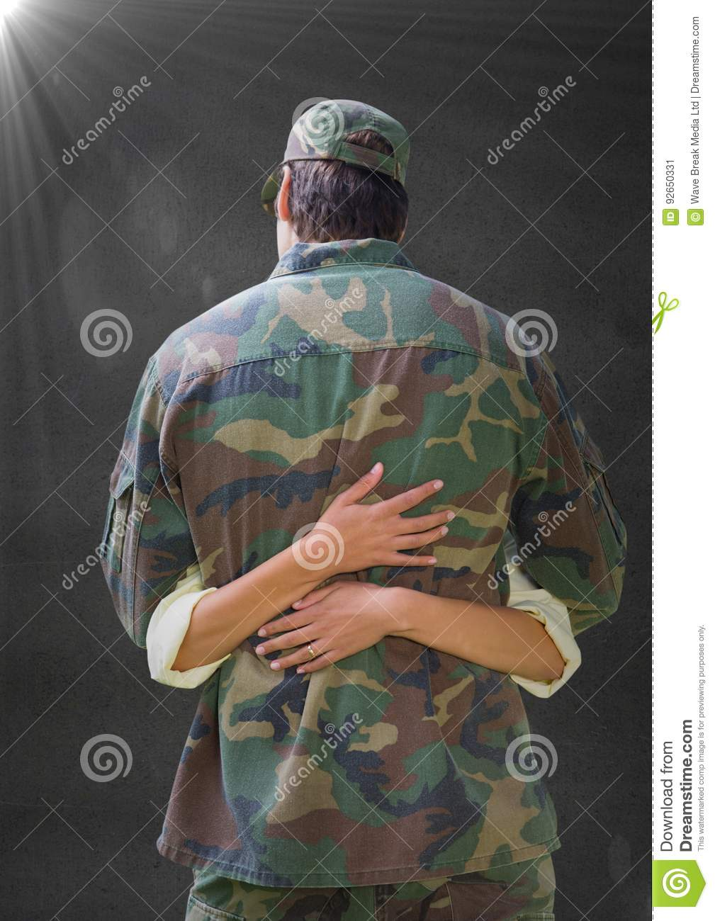 Back of soldier hugging against grey wall with flare