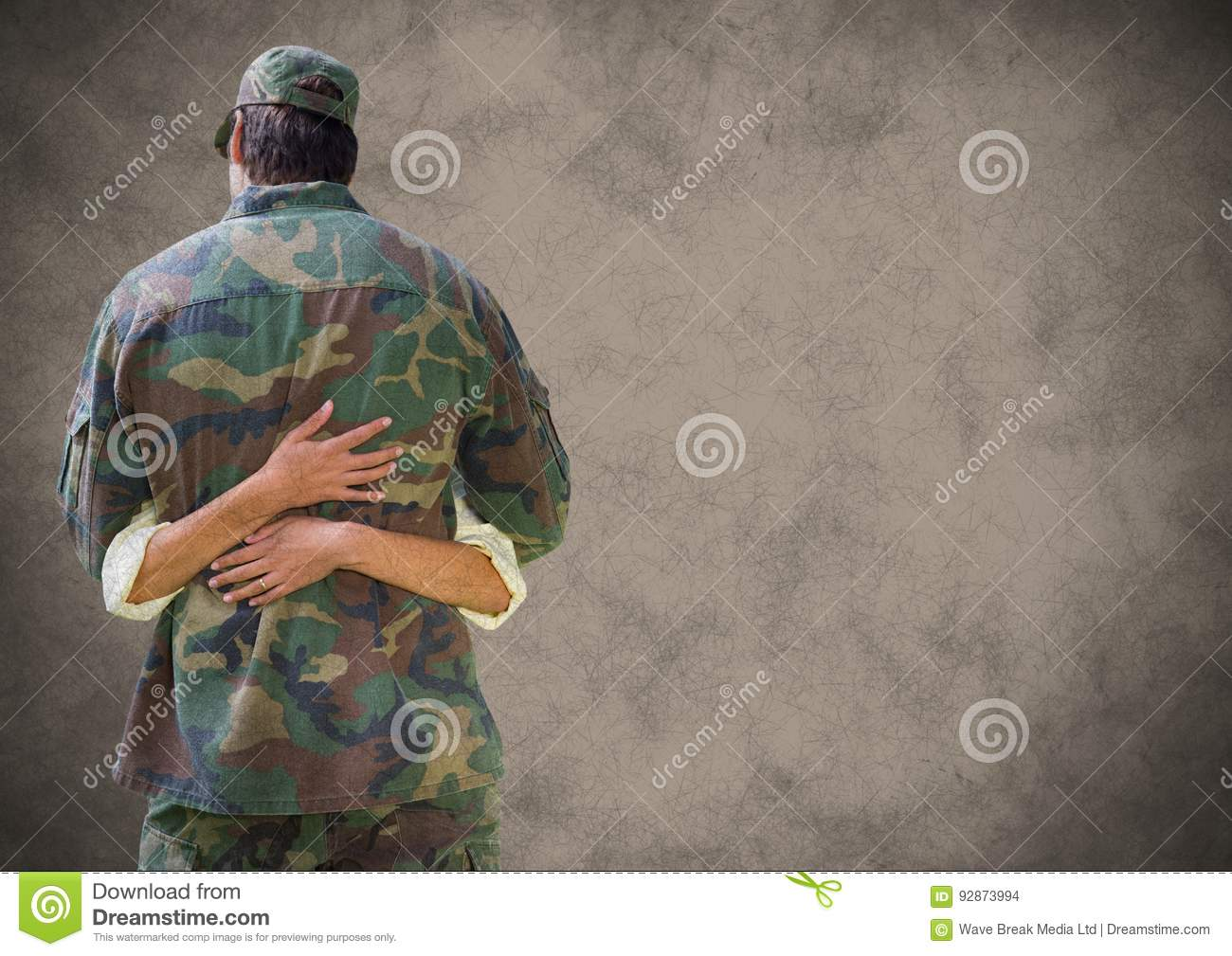 Back of soldier hugging with grunge overlay against brown background