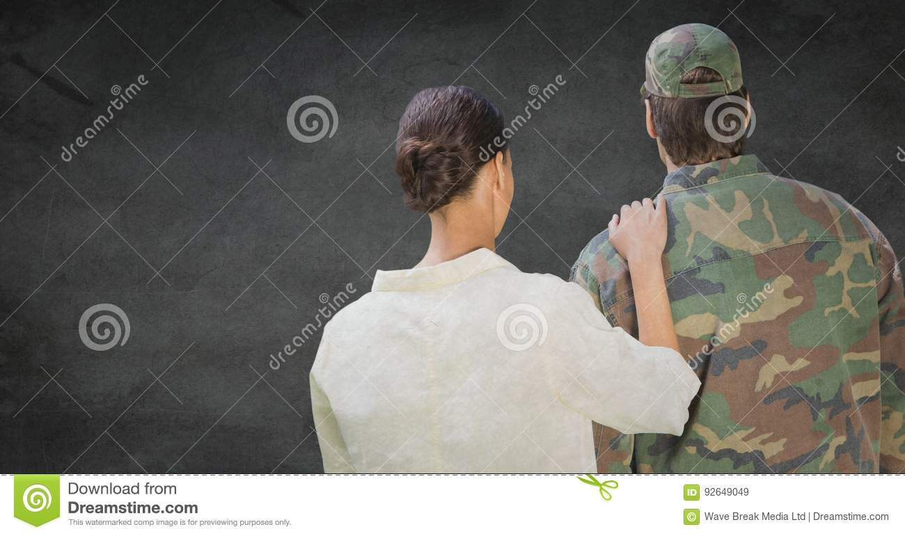 Back of soldier and wife against grey wall with grunge overlay