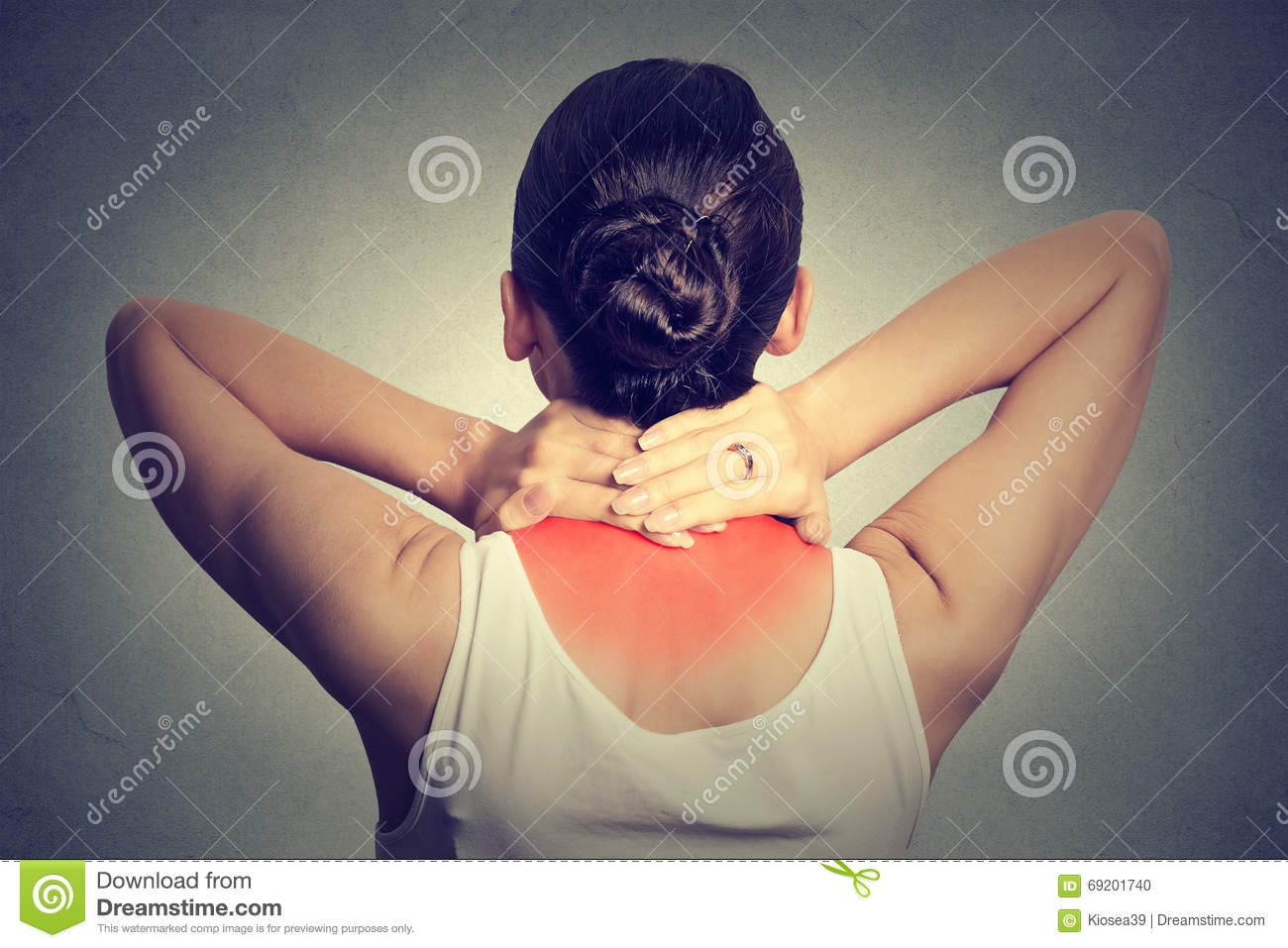 Back and spine disease. Back view of tired female massaging her painful neck