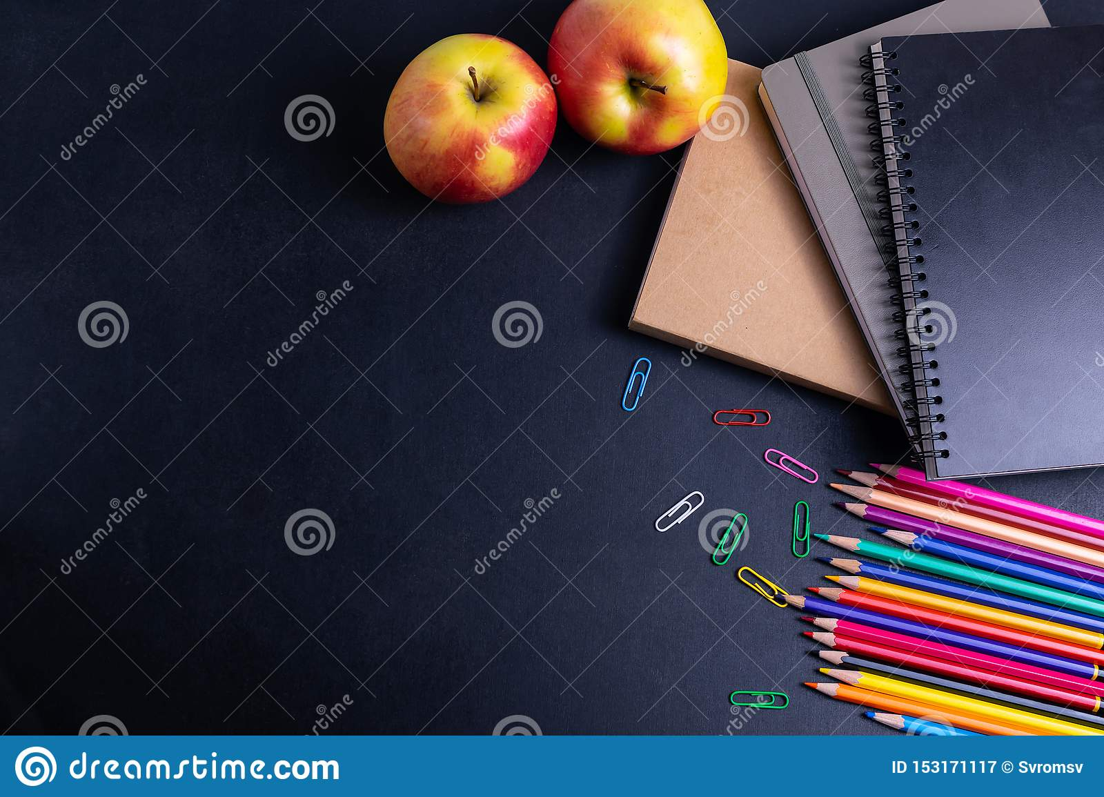 Back to school background with books and apple on blackboard flat lay