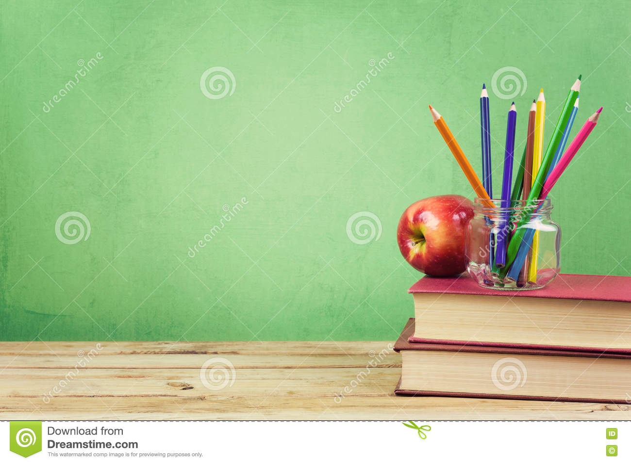 Back to school background with books color pencils and for Apple design book