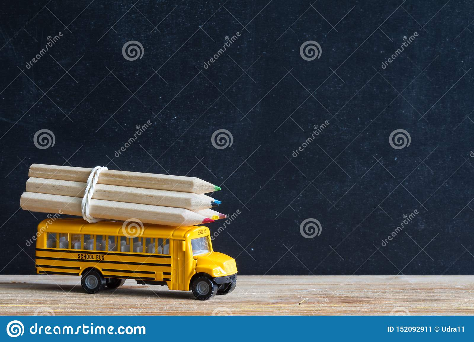 Back to school background concept with bus and accessories on blackboard
