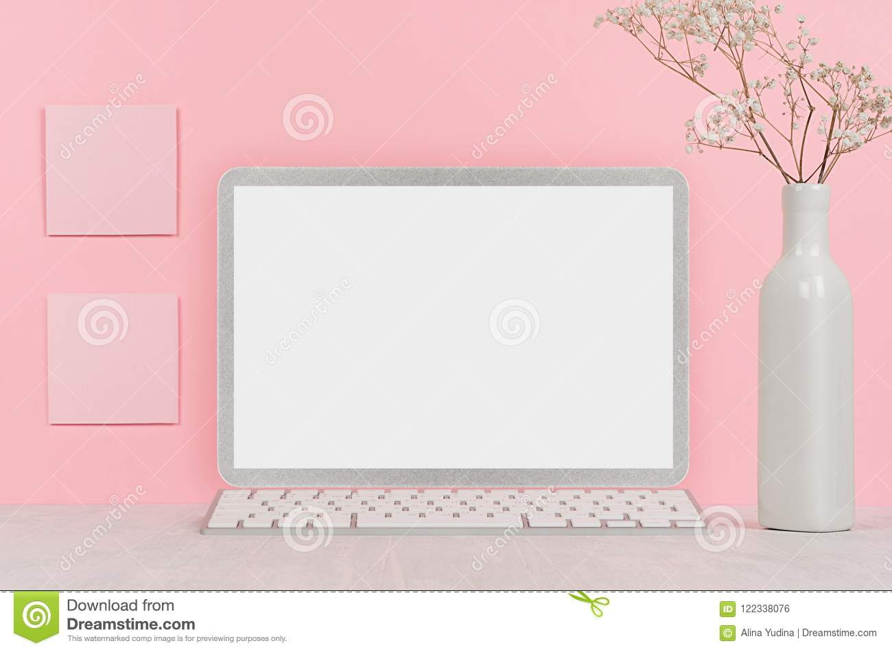 Back to school background for girl`s - white stationery, blank laptop computer and stickers on soft pink wall and white wood desk.