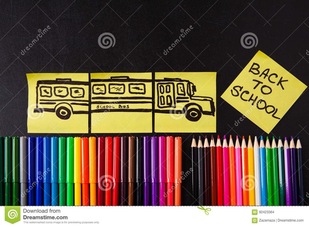 Back to school background with a lot of colorful felt-tip pens and colorful pencils, titles `Back to school`