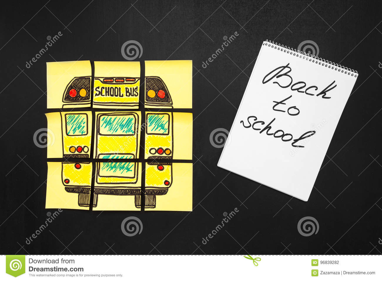 Back to school background with title `Back to school` and `school bus` written on the yellow pieces of paper and notebook