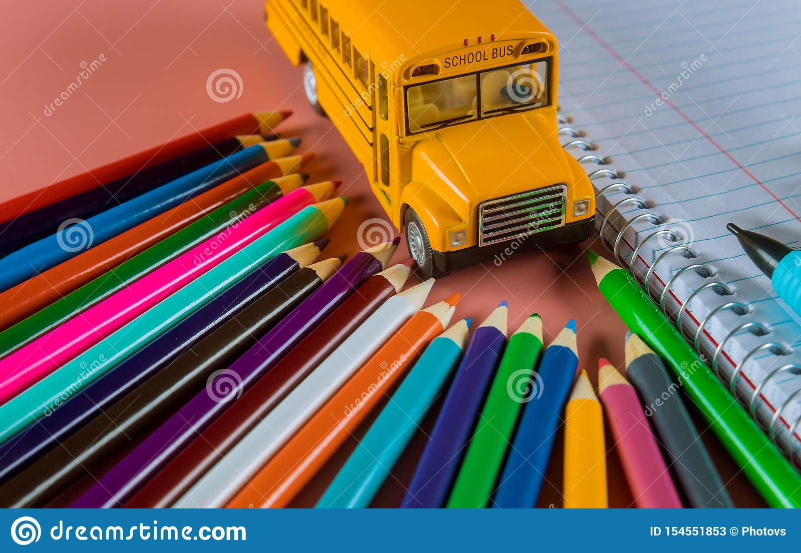 Back to school concept with bus and notebook ,pencil