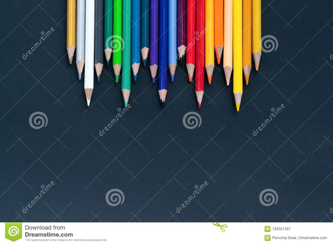 Back to school Concept. Close up shot of color pencil pile pencil nibs on black background with copy space