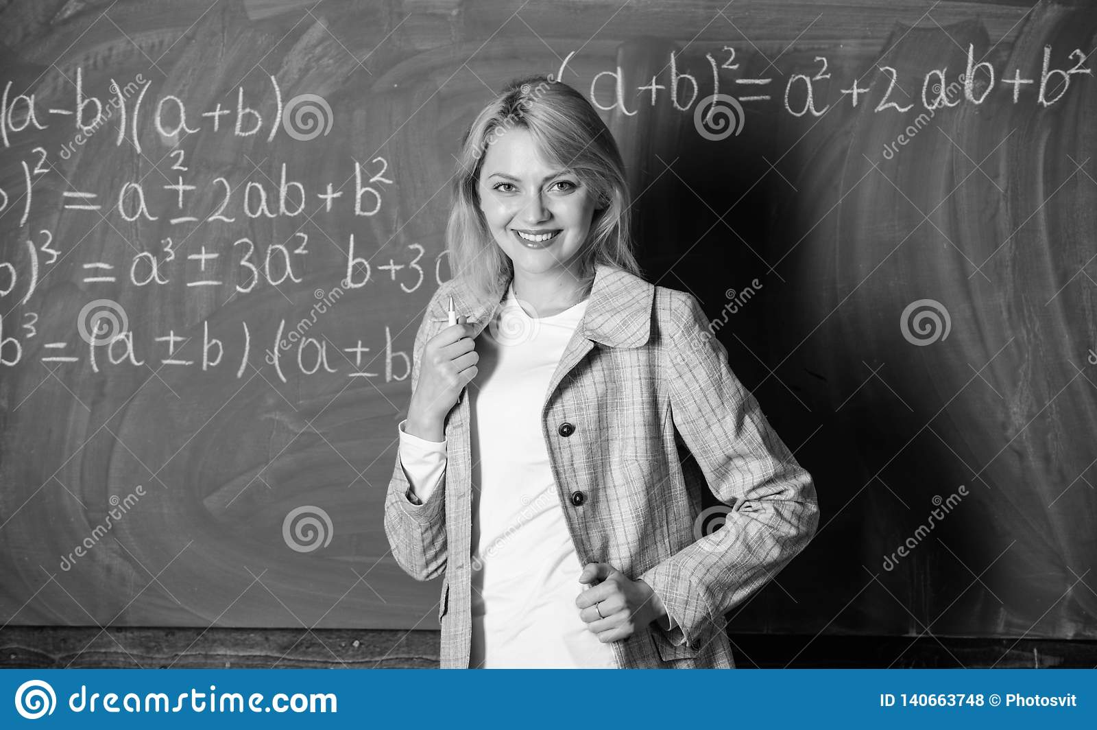 Back to school concept. Woman smiling educator classroom chalkboard background. Working conditions which prospective
