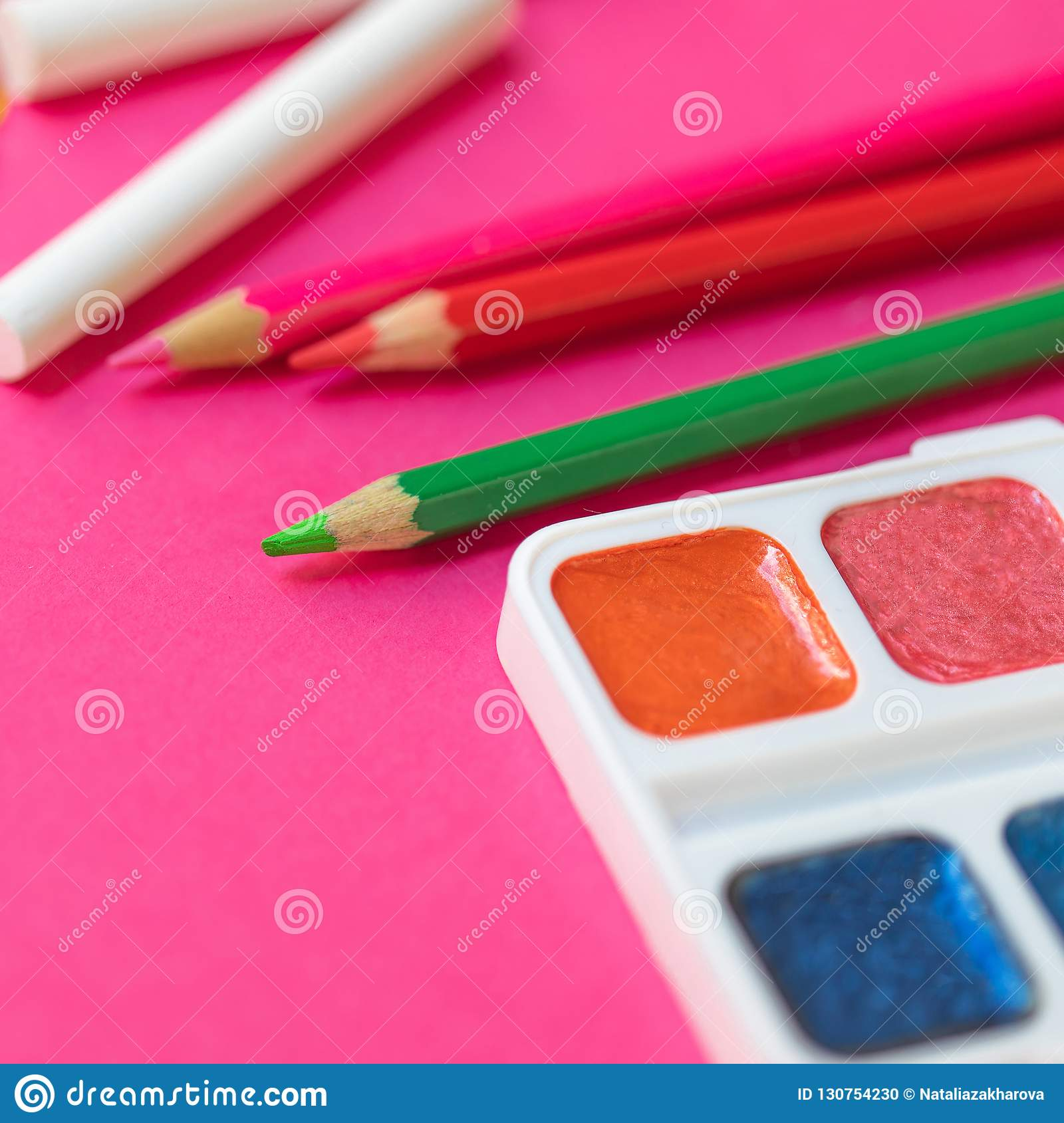 Back to school. Items for the school on pink background. Educa