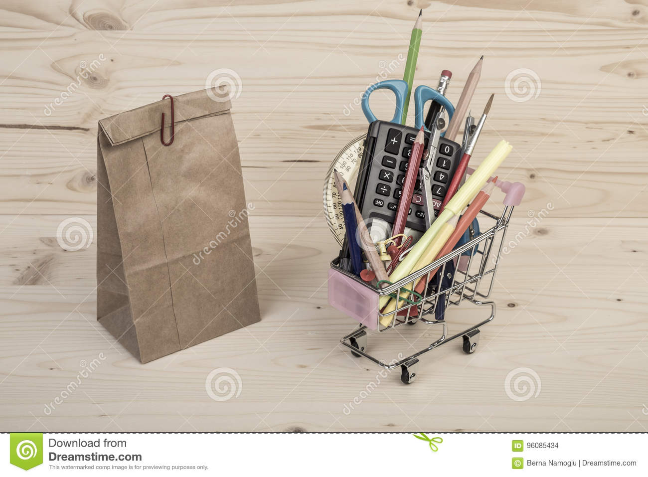 Back To School Template With Multiple Stationery And Paper Lunch Bag On Wooden Table