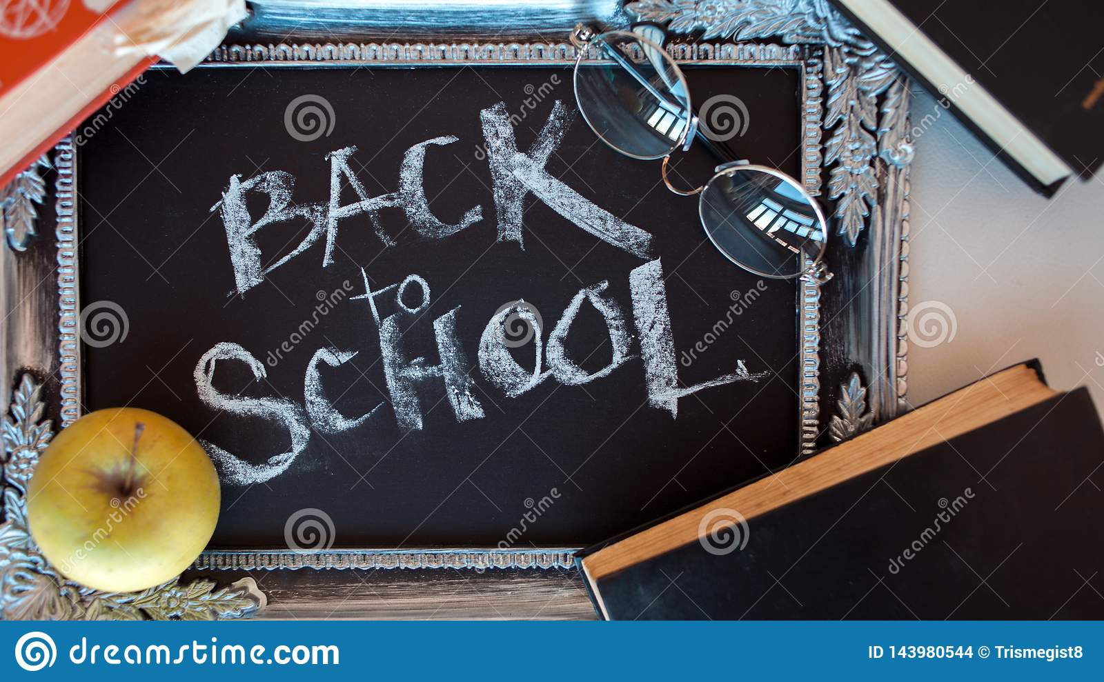 Back to school, Text on chalkboard in a vintage frame.
