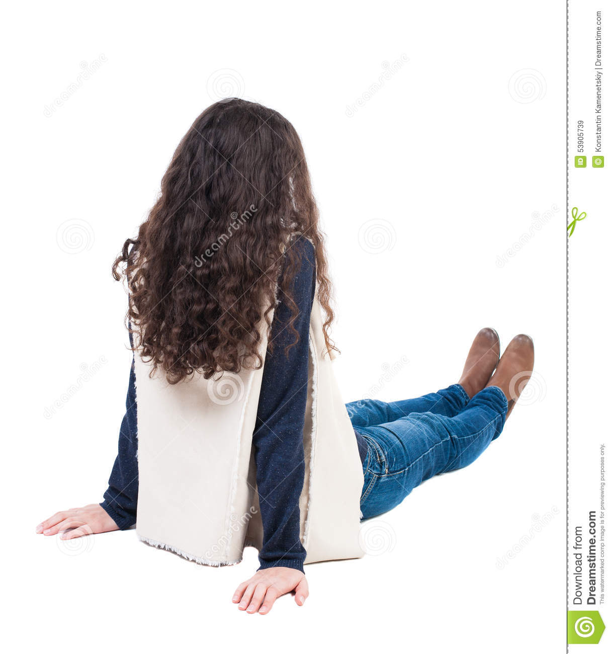 Back view beautiful curly woman sitting on floor and looks for To floor someone