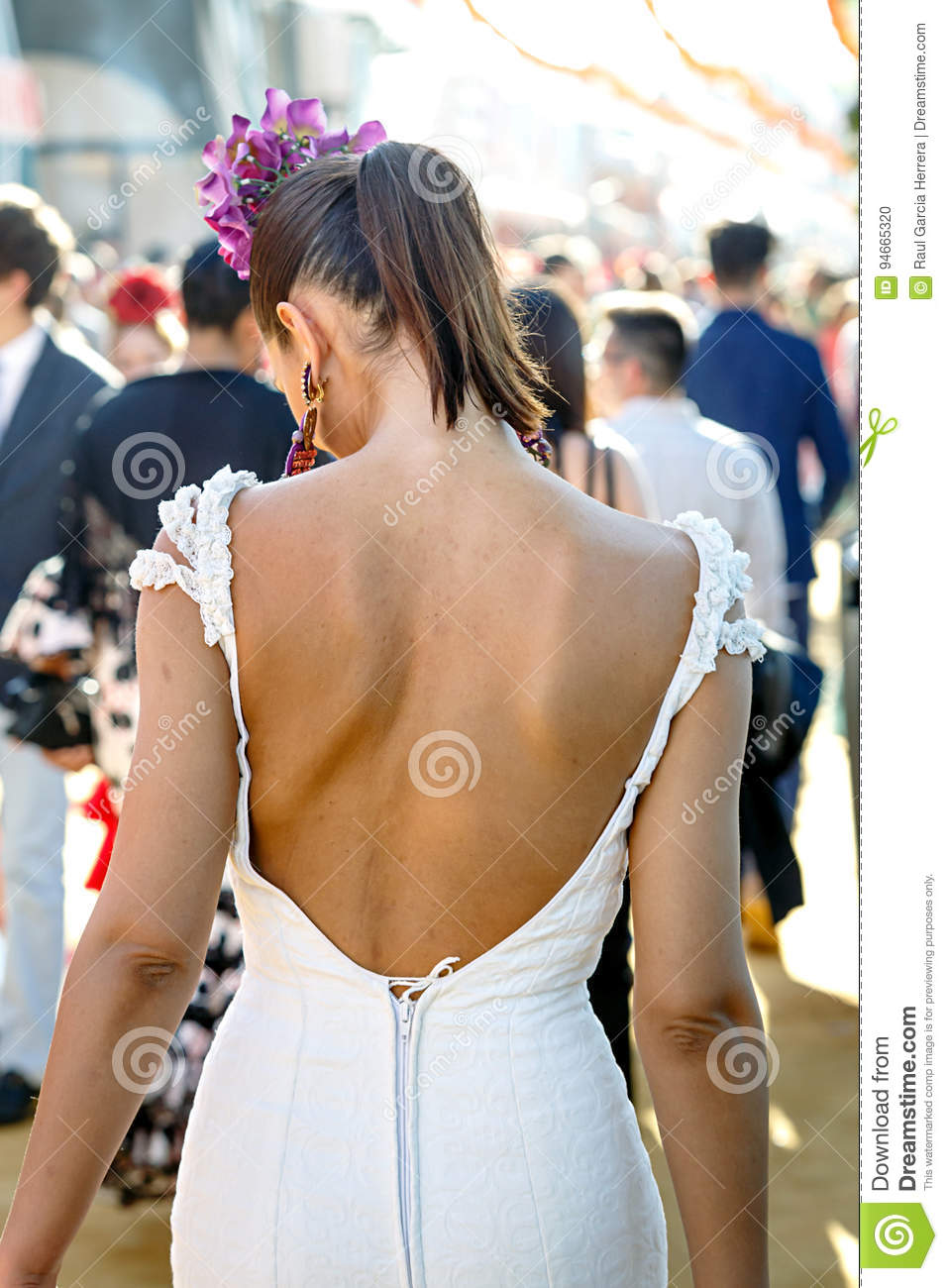 Back View of beautiful fashion woman wearing flamenco dress. Spanish folklore. Seville April Fair