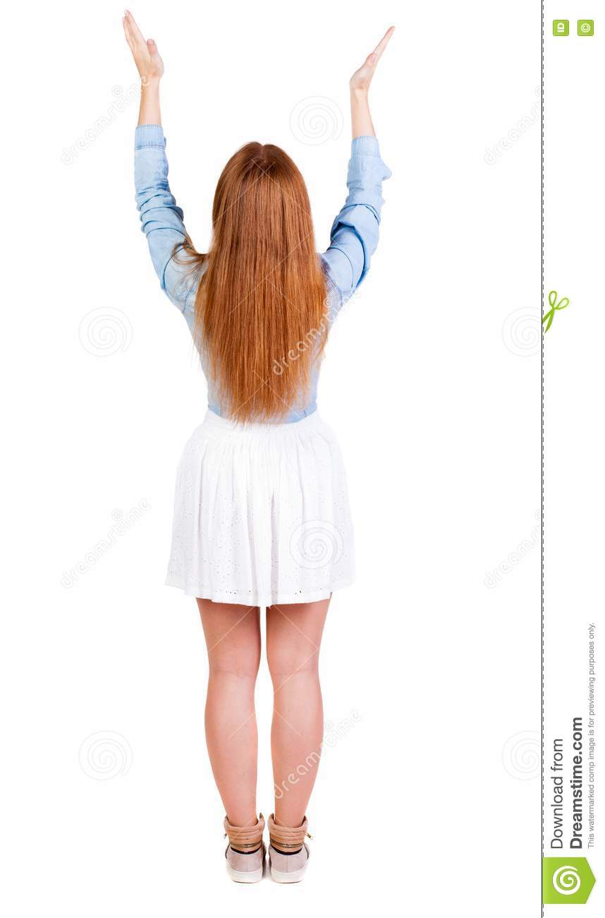 Back view of Beautiful woman in dress looking at wall and Holds