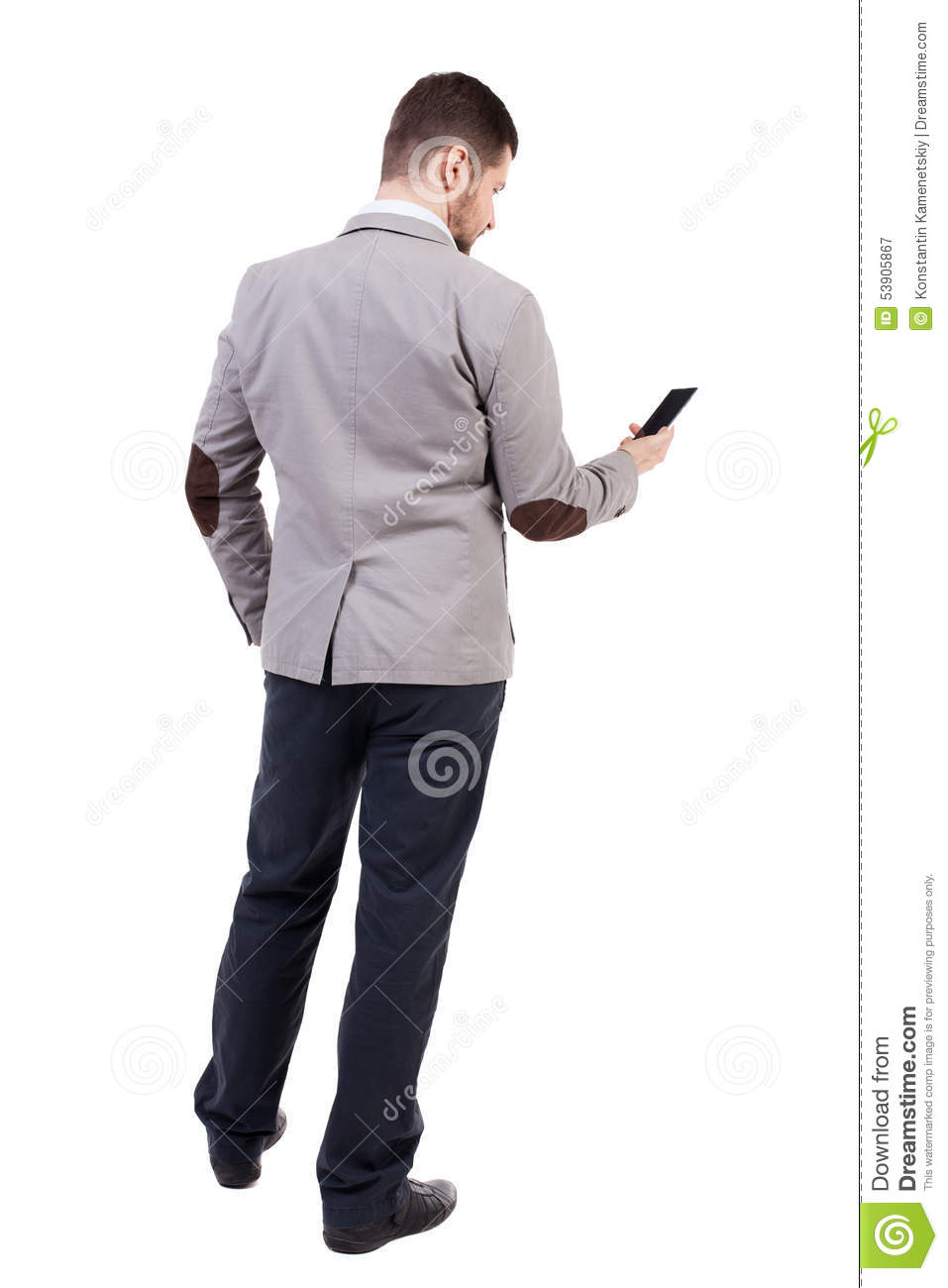 Back View Of Business Man In Suit Talking On Mobile Phone