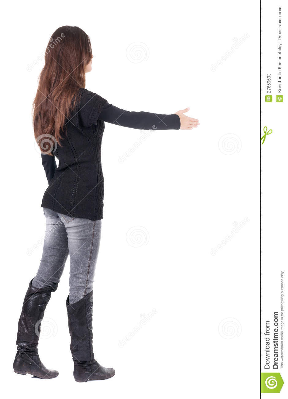 Back View Of Businesswoman Reaches Out To Shake Hands