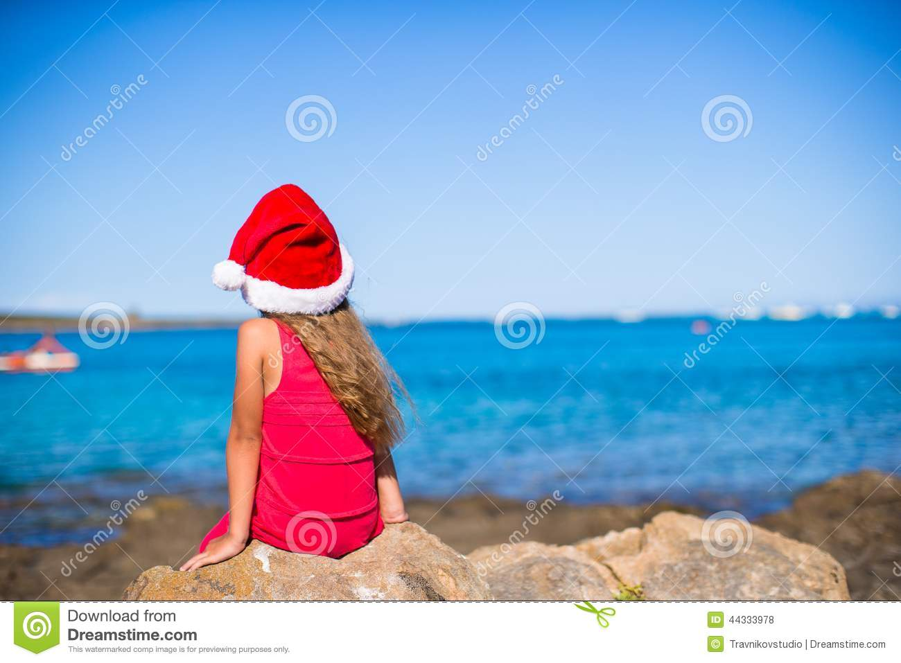 8fd4cfaae49 Back View Of Cute Little Girl In Santa Hat On The Stock Photo ...