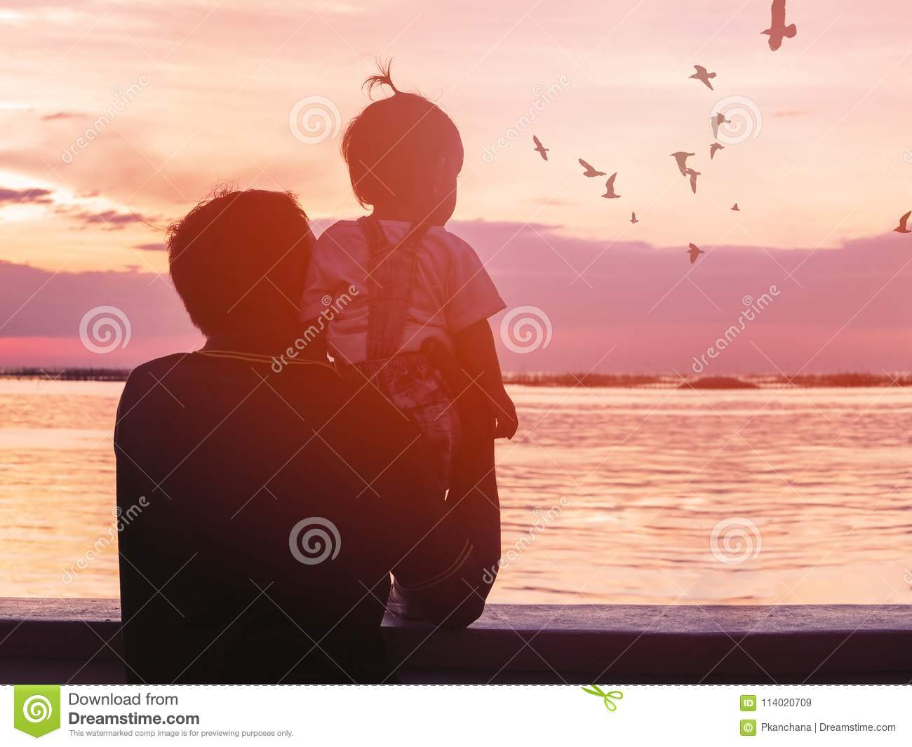 Grandfather and his niece looking at seagull birds