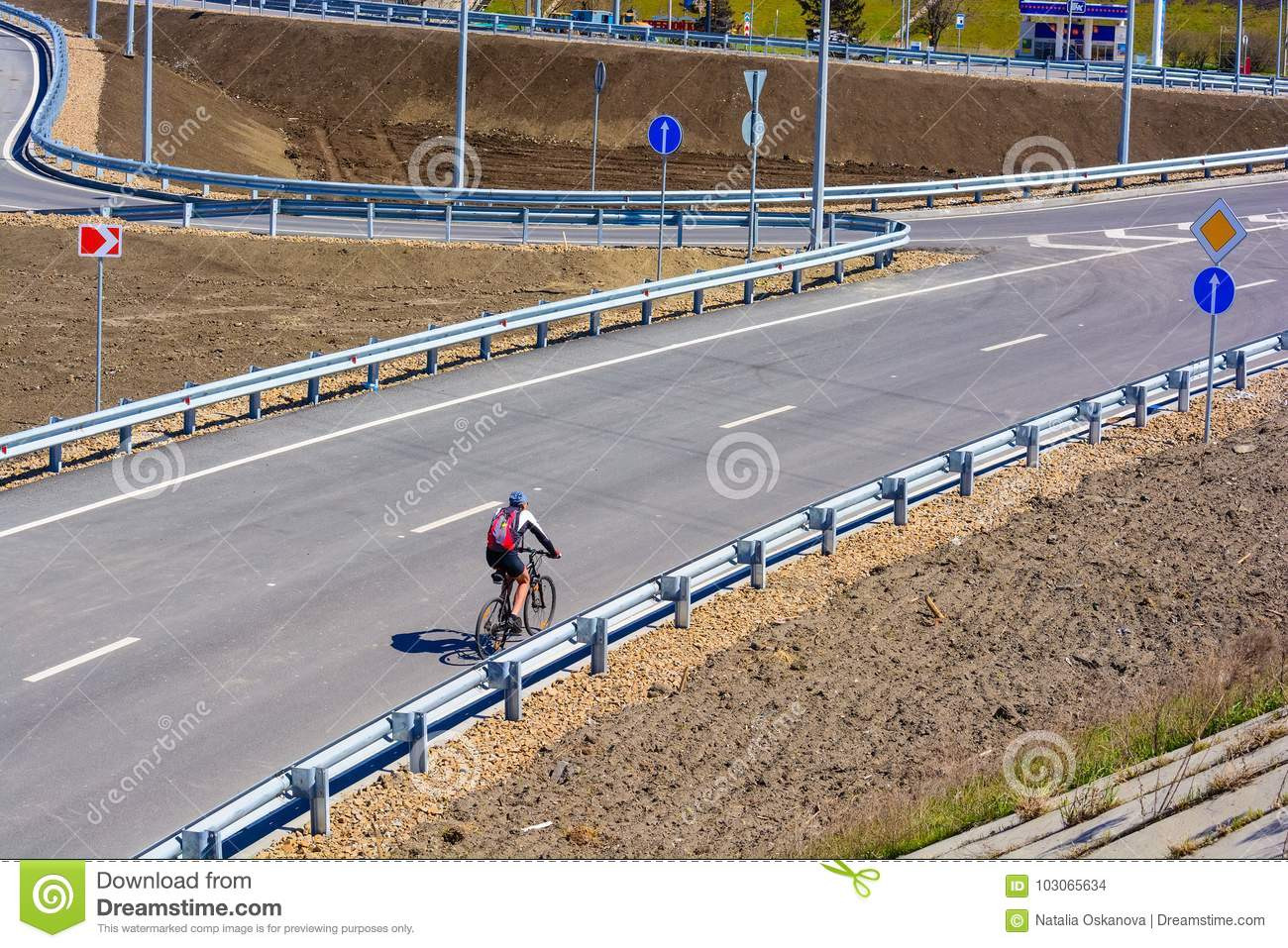 Cyclist on city road with no traffic