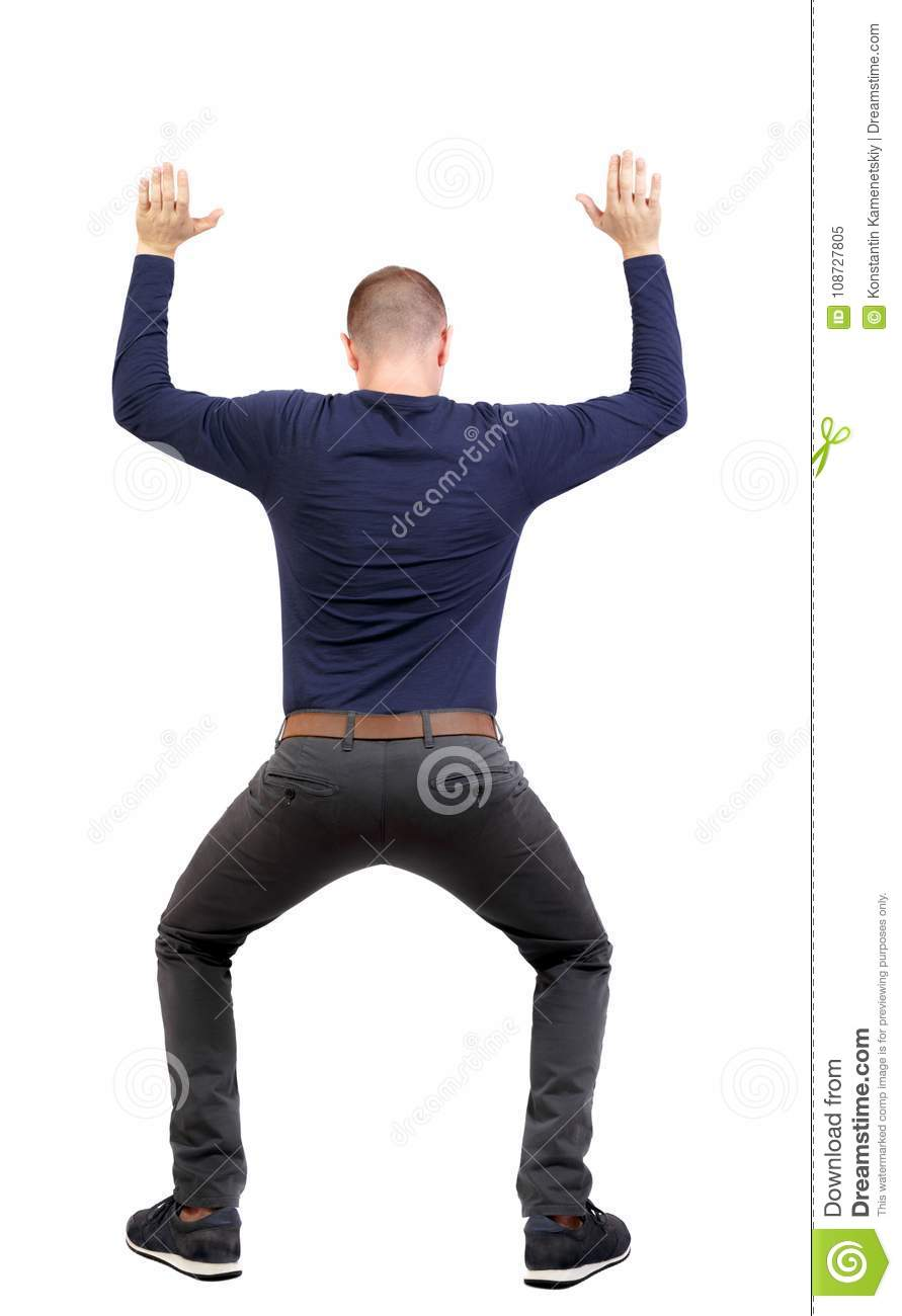 Download Back View. Man  Protects Hands From What Is Falling From Above. Stock Image - Image of caucasian, isolated: 108727805