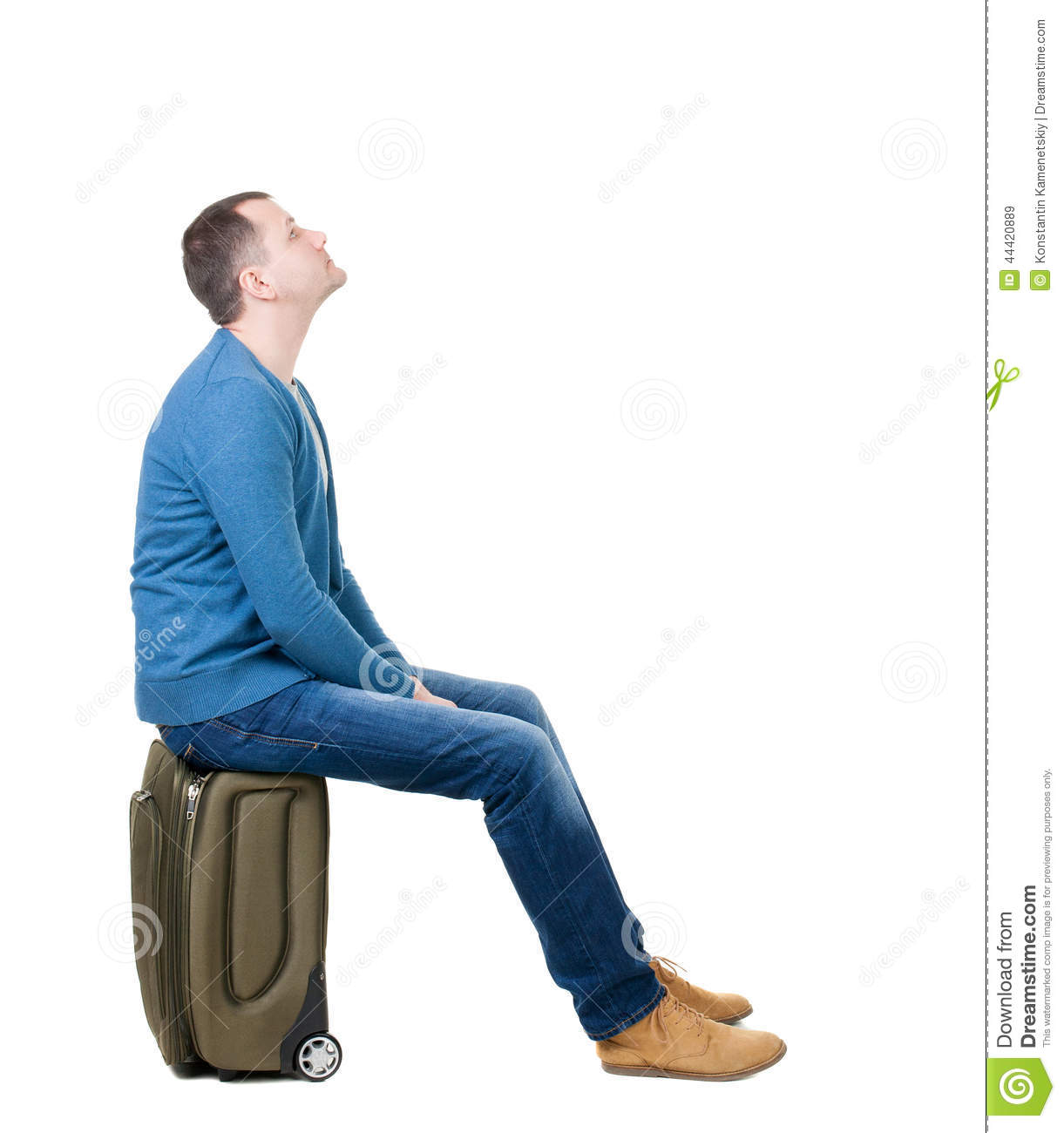 Back View Of A Man Sitting On A Suitcase. Stock Photo ...