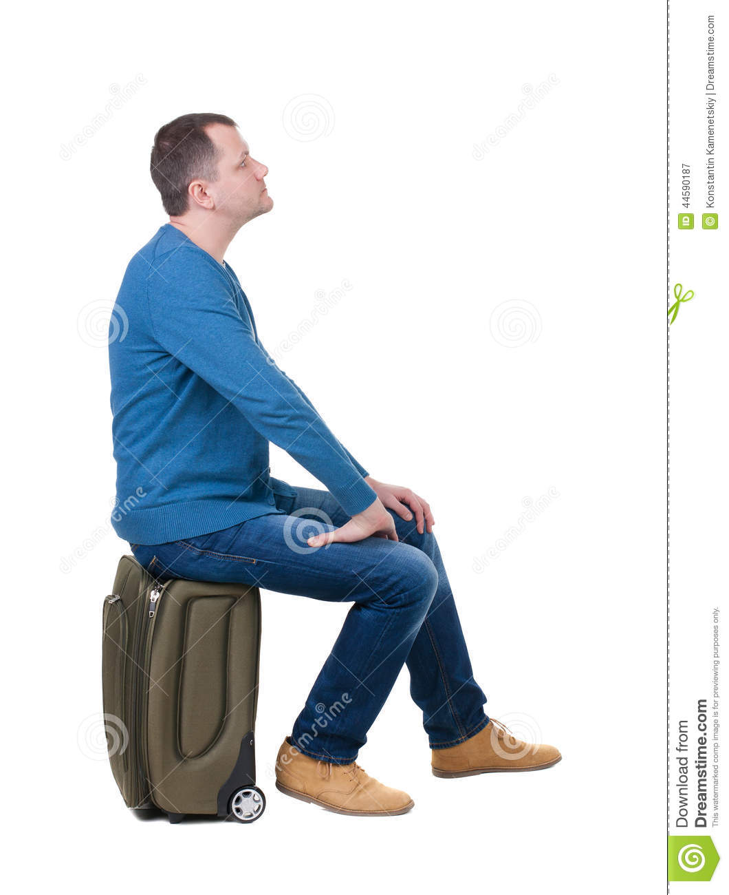 Back View Of A Man Sitting On A Suitcase Stock Image
