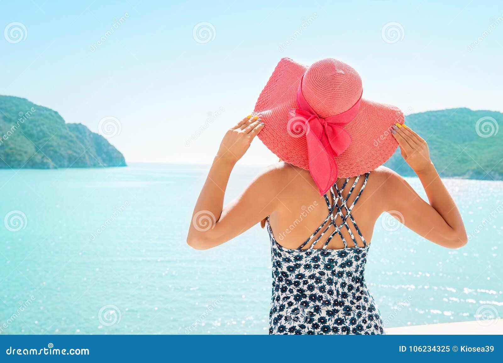 Woman enjoying tropical resort on sea