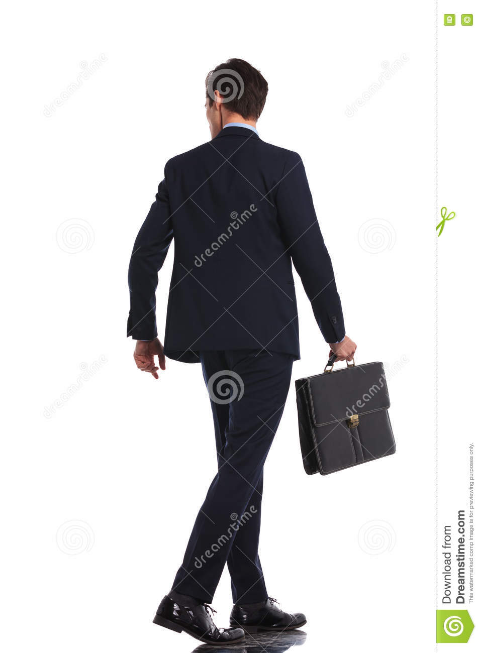 Back view picture of a business man walking with briefcase