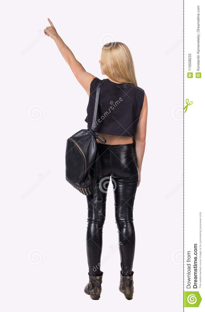c73ae7db1a Back View Of Pointing Woman With A Backpack. Stock Image - Image of ...