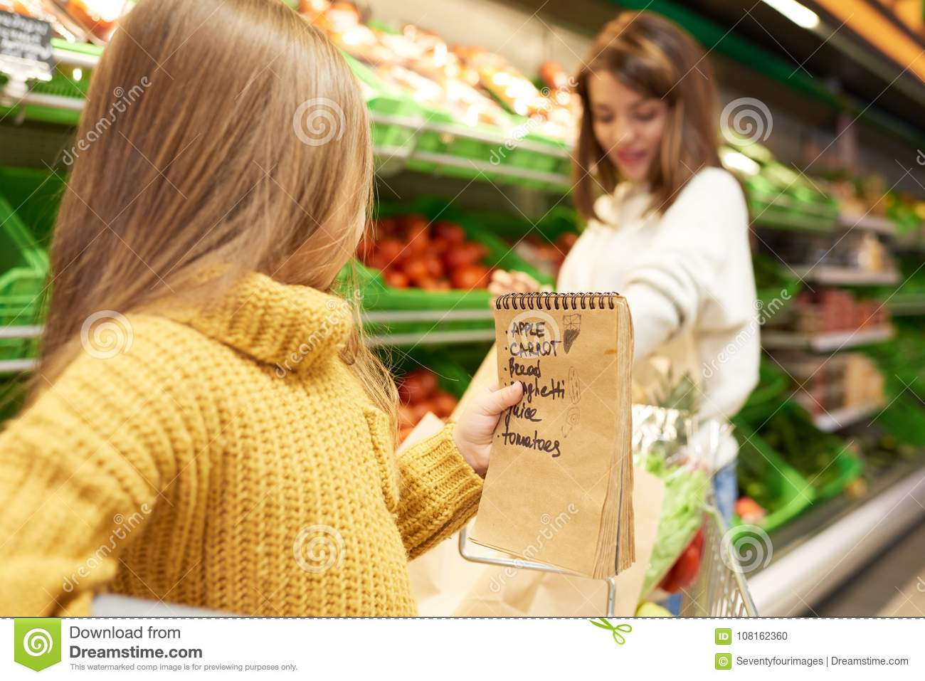 little girl helping grocery shopping