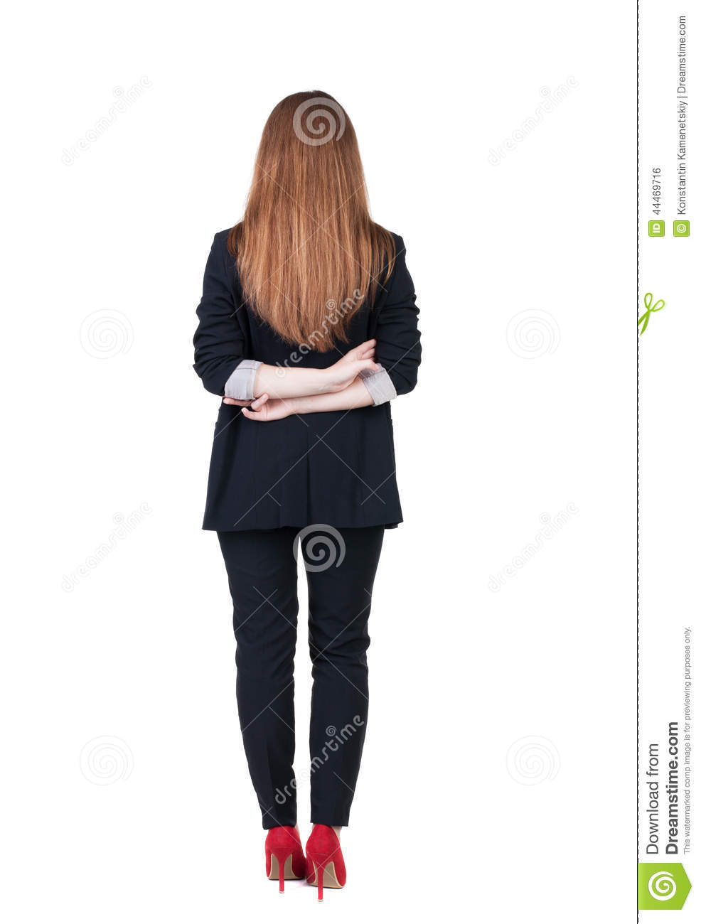 Back view of redhead business woman contemplating.