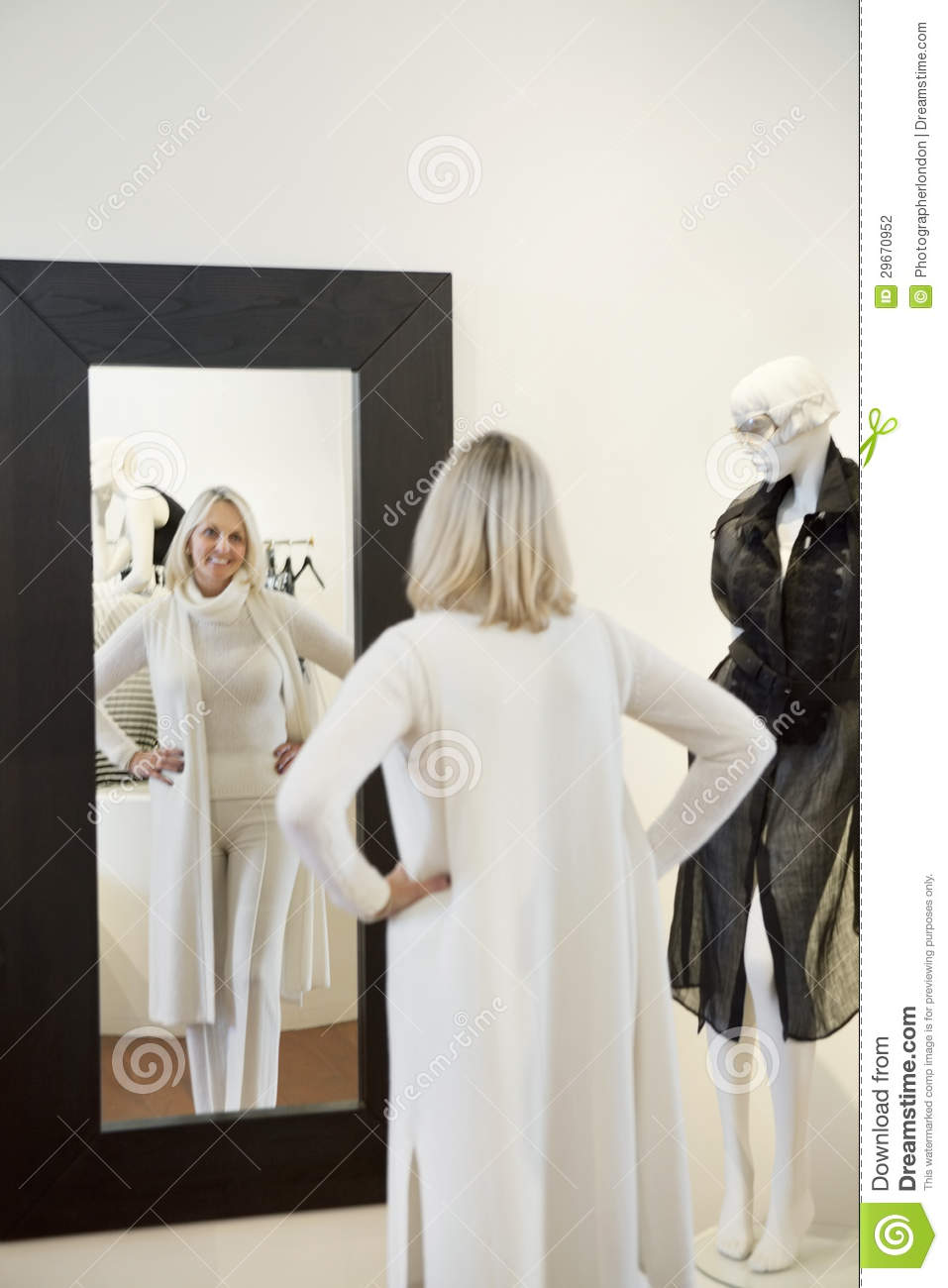 Back view of a senior woman standing with hands on hips in for Looking for mirrors