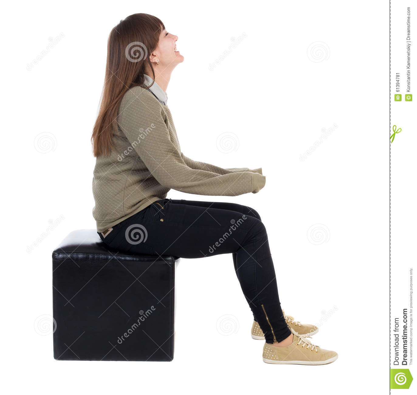 Man sitting in chair side - Back View Of Young Beautiful Woman Sitting Girl Watching Stock Image