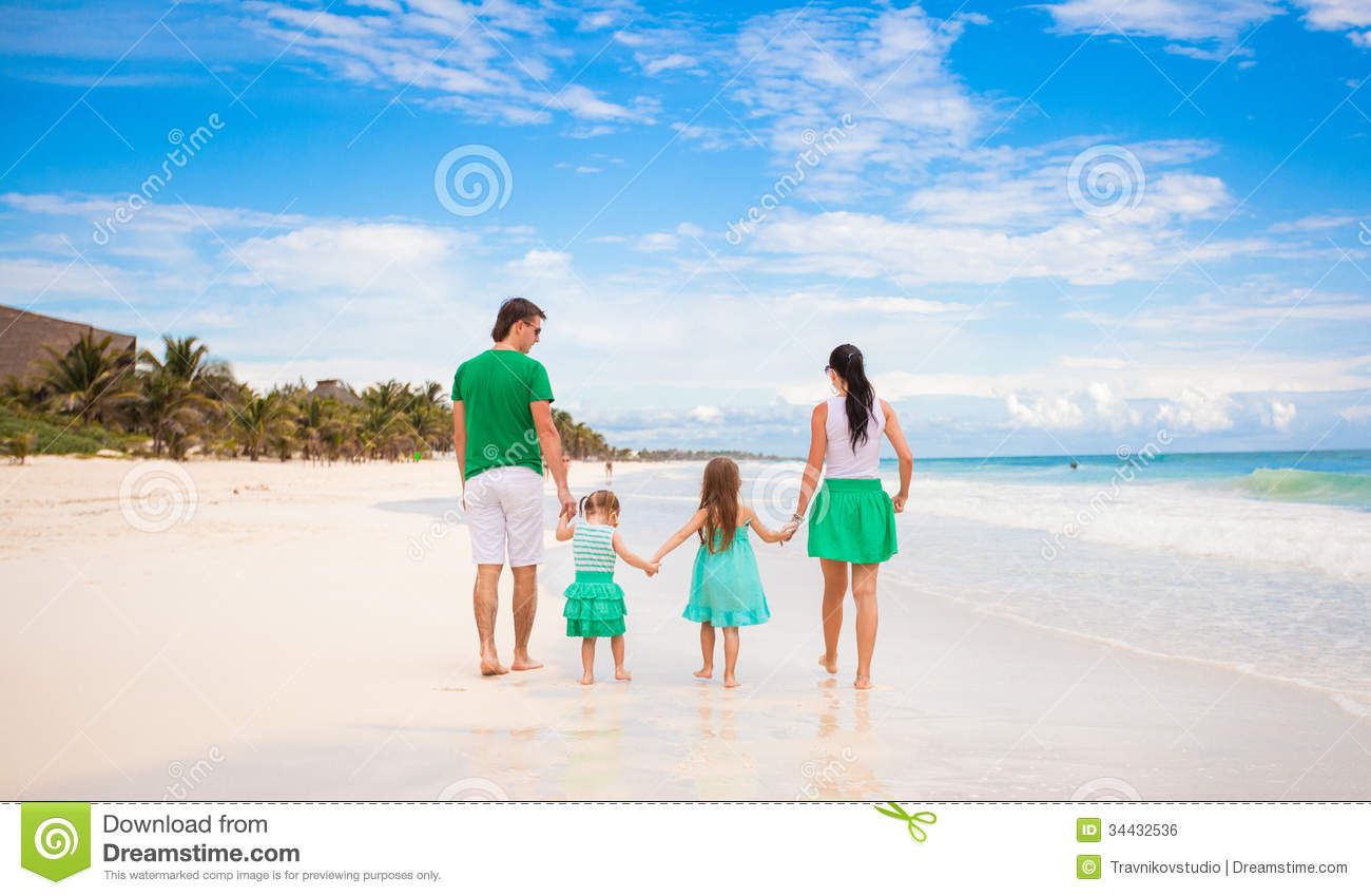 Back view of young family looking to the sea in